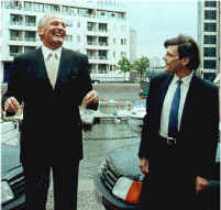 Henry Cooper laughing as he presents me with a car.