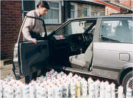 Me with car surrounded by Fairy Liquid bottles for an estimate comp.